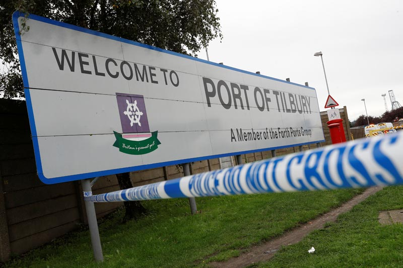 Police tape is seen at the entrance to the Port of Tilbury where the bodies of immigrants are being held by authorities, following their discovery in a lorry in Essex on Wednesday morning, in Tilbury, Essex, Britain October 25, 2019. Photo: Reuters