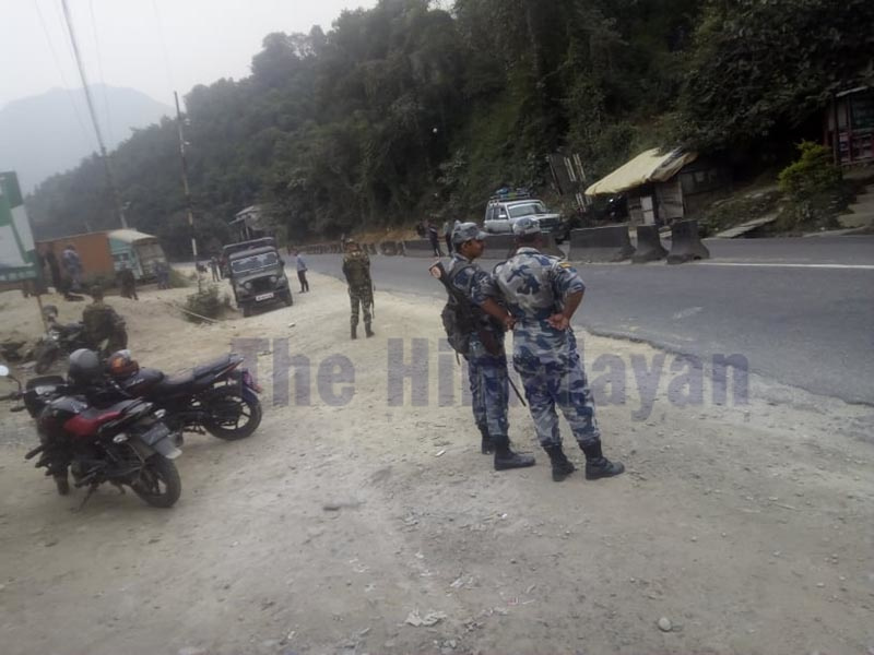 Security personnel securing the site after a pressure cooker bomb was found along Prithivi Highway at Chalise in Dhunibesi Municipality of Dhading district on Sunday, October 20, 2019. Photo: Keshav Adhikari/THT