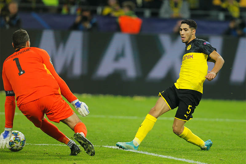 Borussia Dortmund's Achraf Hakimi scores their third goal. Photo: Reuters