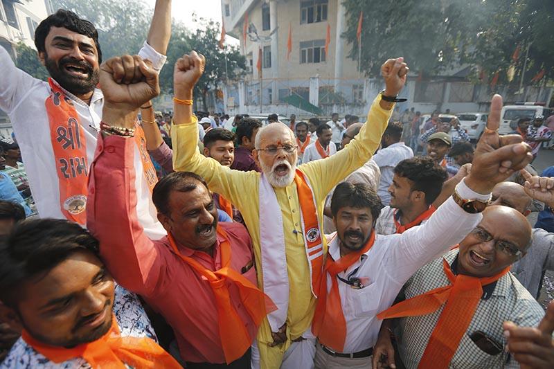 Supporters of Vishwa Hindu Parishad (VHP), or World Hindu Council, celebrate the Supreme Court's verdict outside the VHP office in Ahmadabad, India, Saturday, Nov. 9, 2019. Photo:AP