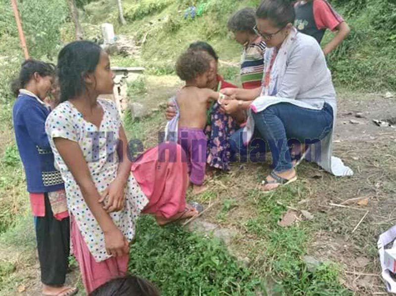 Health worker conducting health check-up of malnourished children in Budhiganga Municipality, Bajura, on Wednesday. An alarming number of children are malnourished here. Photo: THT