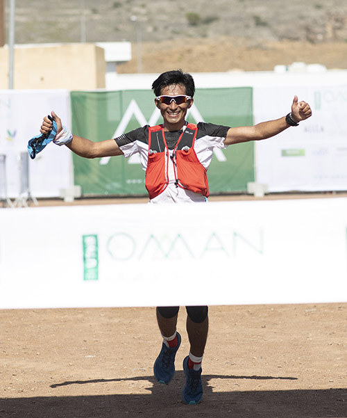 Bhim Bahadur Gurung, winner of the 2019 edition of 50-km ultra race, is pictured crossing the finish line, at Oman by UTMB. Photo Courtesy: Lloyd Images/Kelvin Bruce