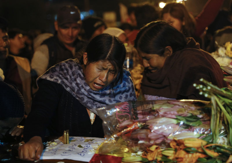 Women mourn over the coffin of a supporter of former President Evo Morales killed during clashes with security forces in Sacaba, Bolivia, Friday, Nov 15, 2019. Photo: AP