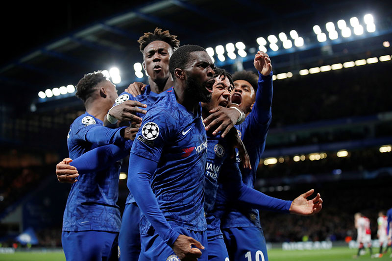 Chelsea's Reece James celebrates scoring their fourth goal with Fikayo Tomori and teammates during the Champions League Group H match between Chelsea and Ajax Amsterdam, at Stamford Bridge, in London, Britain, on November 5, 2019. Photo: Reuters