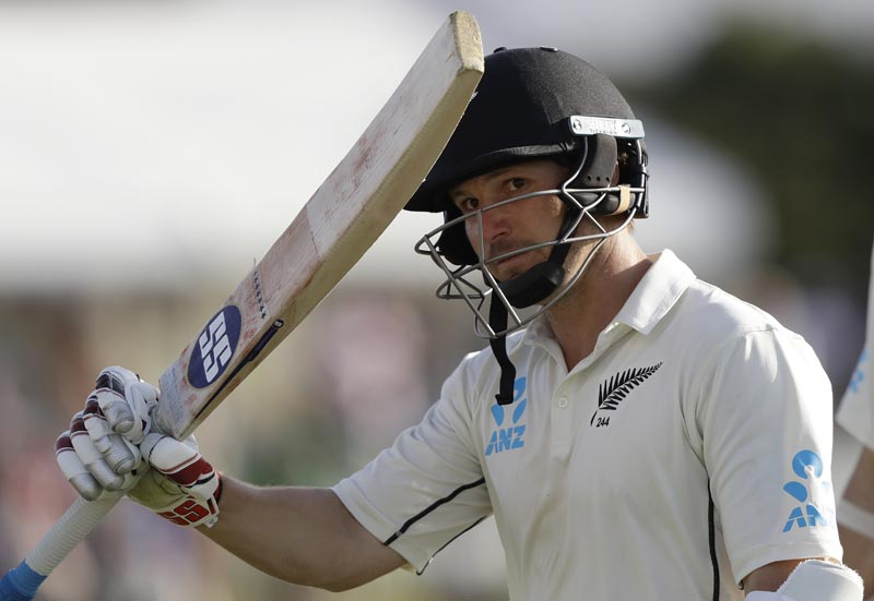 New Zealand's BJ Watling waves his bat to the crowd as he leaves the field 119 not out at the close of play on day three of the first cricket test between England and New Zealand at Bay Oval in Mount Maunganui, New Zealand, Saturday, November 23, 2019. Photo: AP