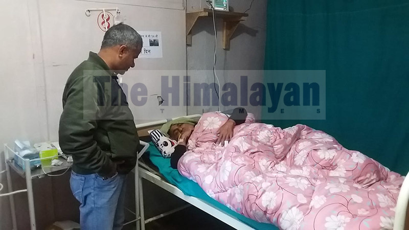 Dr Govinda KC lies on a hospital bed in Dadeldhura Hopital, on Saturday, November 9, 2019. The senior doctor was taken to the hospital for treatment after his health started weakening during the course of hunger strike. Photo: Baburam Shrestha/THT