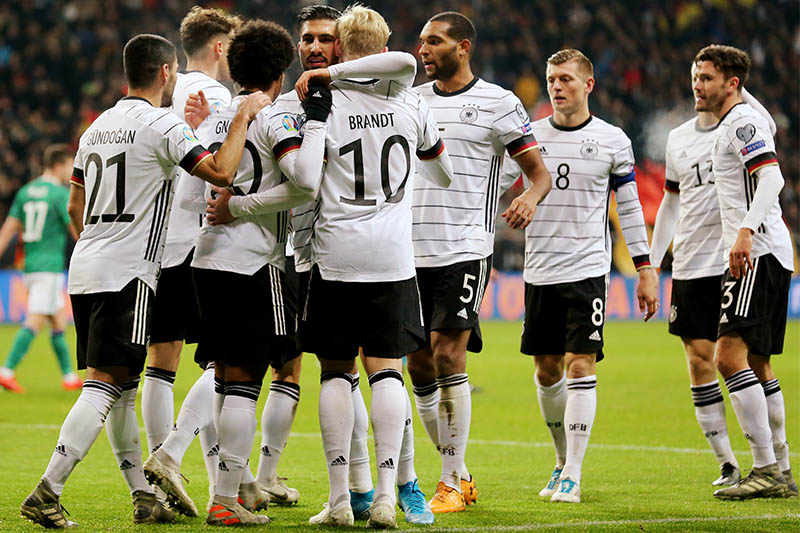 Germany's Serge Gnabry celebrates scoring their fourth goal with teammates. Photo: Reuters