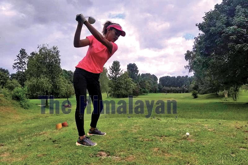 Golfer Rabina Shrestha plays a shot during the selection tournament for the SA Games at the Tribhuvan Army Officers Golf Club in Kathmandu on Monday. Photo: THT
