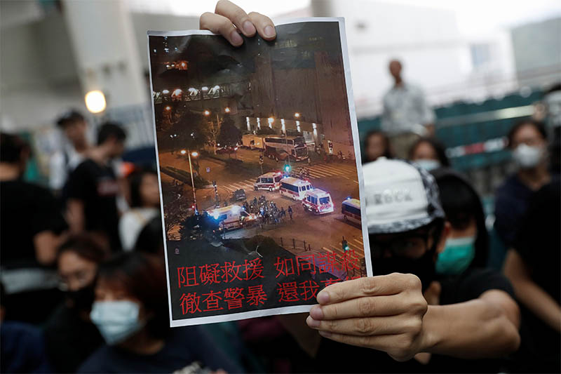 A student from the Hong Kong University of Science and Technology holds up a sign during a forum on fellow injured student Chow in Hong Kong, China, November 6, 2019. Photo: Reuters