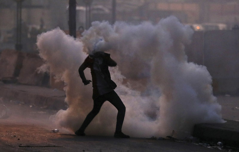 An anti-government protester is surrounded by tear gas fired by Iraqi security forces in an effort to disperse demonstrators, in central Baghdad, Iraq, Sunday, Nov 10, 2019. Photo: AP