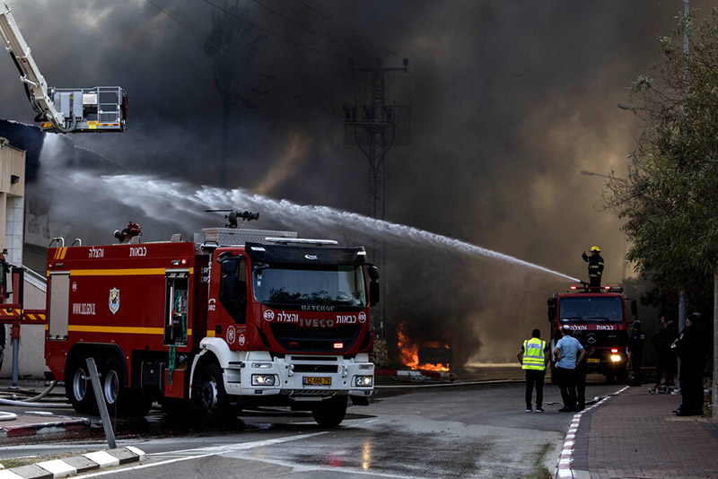 Firefighters deploy after a factory hit by a rocket caught fire in Sderot, southern Israel, on Tuesday, November 12, 2019. Israel has killed a senior Islamic Jihad commander in Gaza in a rare targeted killing that threatened to unleash a fierce round of cross-border violence with Palestinian militants. Photo: AP