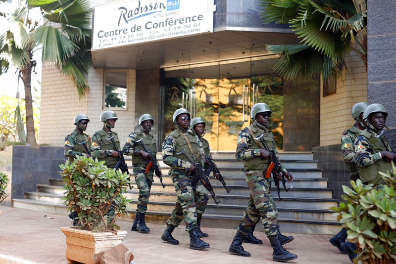 In this Saturday, November 21, 2015, soldiers from the presidential guard patrol outside the Radisson Blu hotel in Bamako after it was attacked by Islamic extremists armed with guns and grenades. Photo: AP