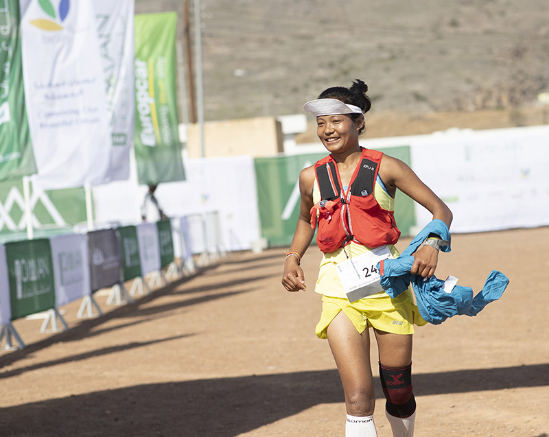 Mira Rai, Nepali ultra trail runner is pictured crossing the finish line, at Oman by UTMB. Photo Courtesy: Lloyd Images/Kelvin Bruce