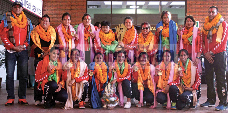 Nepal national women's volleyball team members pose for a group photo upon their arrival at the Tribhuvan International Airport, in Kathmandu, on Friday, November 15, 2019. Photo: Udipt Singh Chhetry/THT