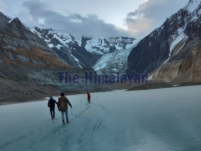 People walking on the frozen lake located at the height of 4,190 metres above sea level near the North Annapurna Base Camp, Myagdi. Photo: Rup Narayan Dhakal/THT