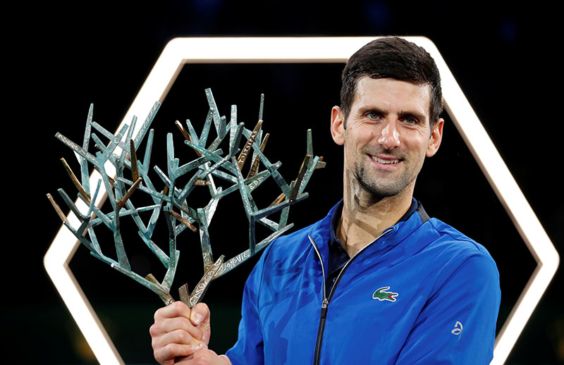 Serbia's Novak Djokovic celebrates with the trophy after winning the Paris Masters during the ATP 1000  Paris Masters, at AccorHotels Arena, in Paris, France, on November 3, 2019. Photo: Reuters