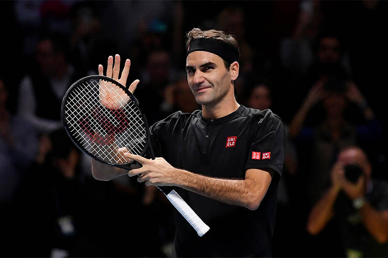 Switzerland's Roger Federer celebrates after winning his group stage match against Serbia's Novak Djokovic. Photo: Reuters