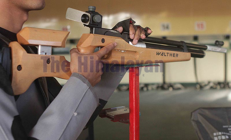 FILE - A shooter holds an old air rifle while aiming at target in menu2019s 10 meters air rifle at shooting range of International Sports Complex, Satdobato in Lalitpur on Thursday. Photo: Udipt Singh Chhetry/ THT