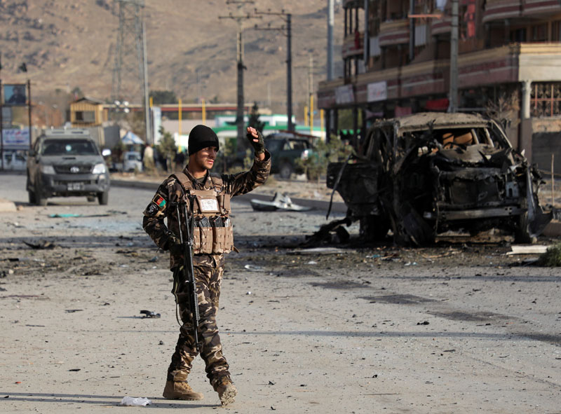 A member of the Afghan security forces keeps watch at the site of a suicide blast in Kabul, Afghanistan November 13, 2019. Photo: Reuters