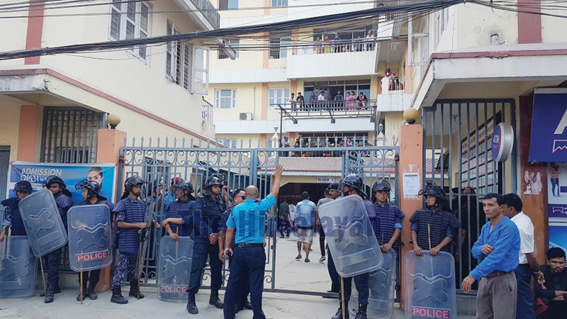 Security personnel guarding Birat Nursing Home, in Biratnagar, on Friday. Photo: THT