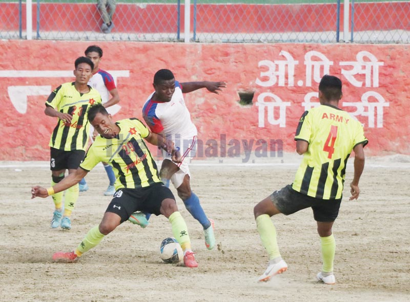 Players of Tribhuvan Army Club and Brigade Boys Club (centre) vies for the ball during their third Chandragiri Mayor Gold Cup Football Tournament match in Naikap on Thursday, November 21, 2019. Photo: THT