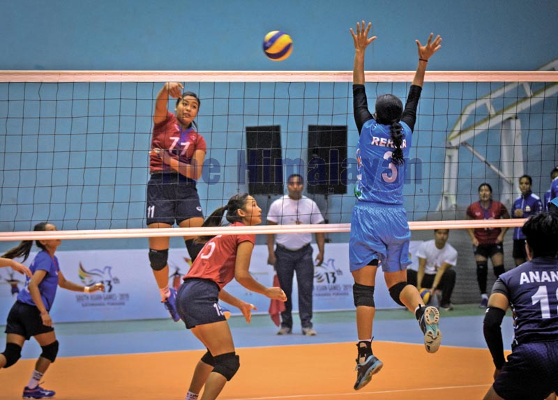 Action in the match between Nepal (left) and India during the womenu2019s volleyball tournament under the 13th South Asian Games in Kathmandu on Thursday, November 28, 2019. Photo: Naresh Shrestha / THT