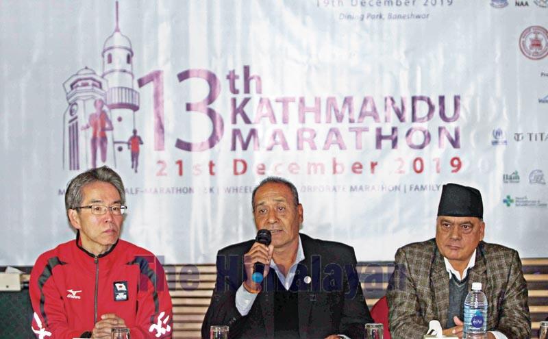 Chief organiser Nilendra Raj Shrestha speaks as Province-3 Tourism Minister Arun Prasad Nepal (right) and former athletics coach Kazuaki Naganuma look on during a press meet of the 13th Kathmandu Marathon on Thursday, December 19, 2019. Photo: THT