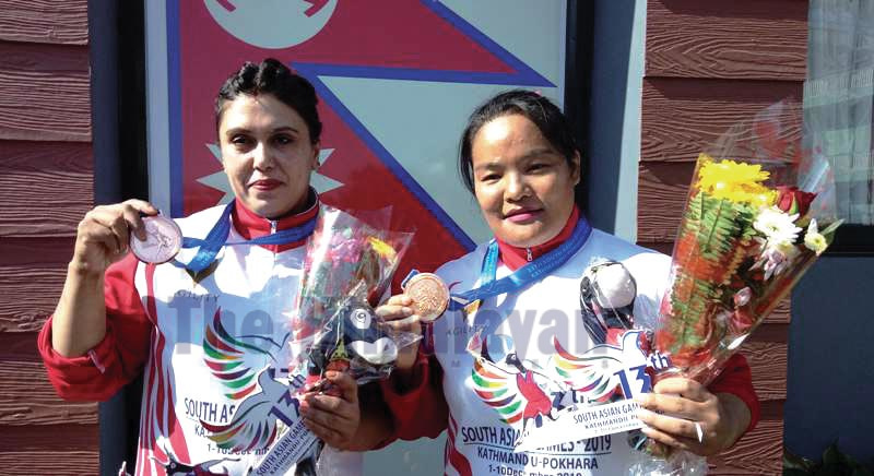 Lifters Tara Devi Pun (right) and Laxmi Ban with bronze medals in the 13th South Asian Games on Saturday, December 7, 2019. Photo: THT