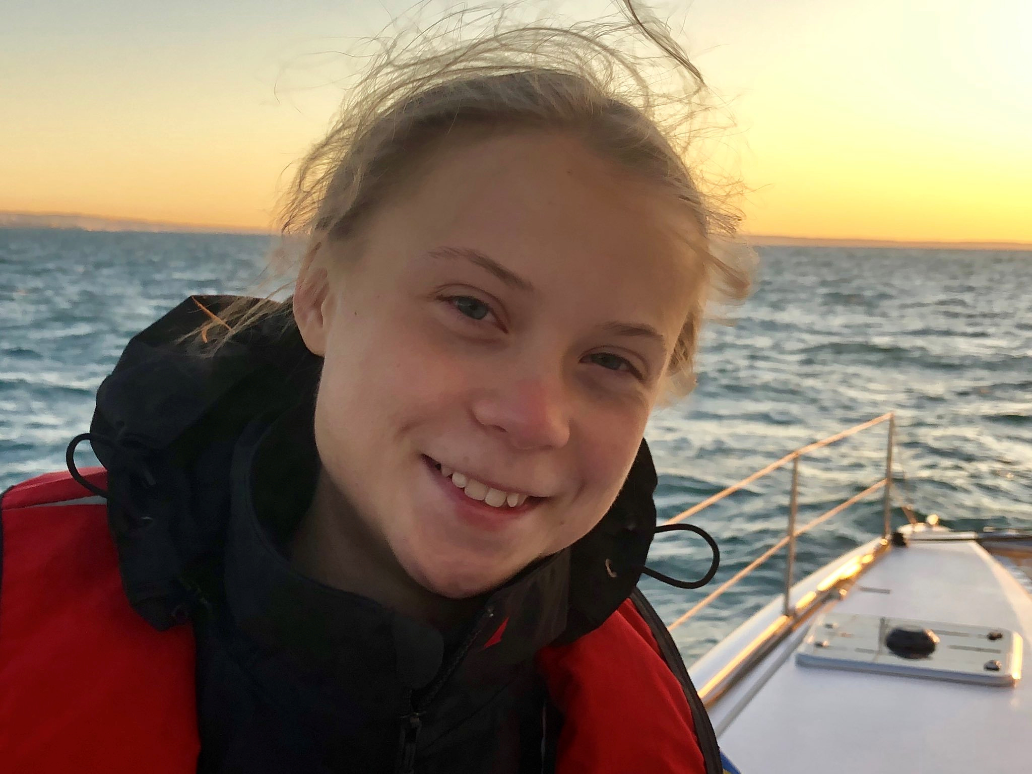 Climate change activist Greta Thunberg, aboard the yacht La Vagabonde, smiles as she heads into Santo Amaro port in Lisbon, Portugal, December 3, 2019 in this picture obtained from social media. Greta Thunberg via REUTERS THIS IMAGE HAS BEEN SUPPLIED BY A THIRD PARTY. MANDATORY CREDIT. NO RESALES. NO ARCHIVES.