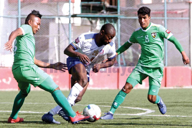 Machhindra Football Clubu2019s Somide Oluwawunmi Adelaja (centre) vies for the ball with New Road Team players during their Qatar Airways Martyrs Memorial A Division League match at the ANFA Complex grounds in Lalitpur on Monday, December 30, 2019. Photo: Udipt Singh Chhetry /THT