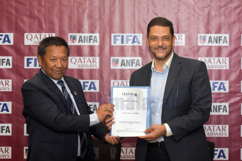 ANFA President Karma Tsering Sherpa (left) and Country Manager of Qatar Airways Mohamed El Emam exchange agreement papers in Lalitpur on Thursday, December 12, 2019. Photo: Naresh Shrestha / THT