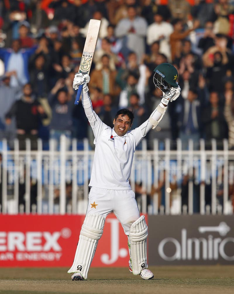 Pakistani batman Abid Ali celebrates after completing his century during the fifth-day of the 1st cricket test match between Pakistan and Sri Lanka, in Rawalpindi, Pakistan, Sunday, December 15, 2019. Photo: AP