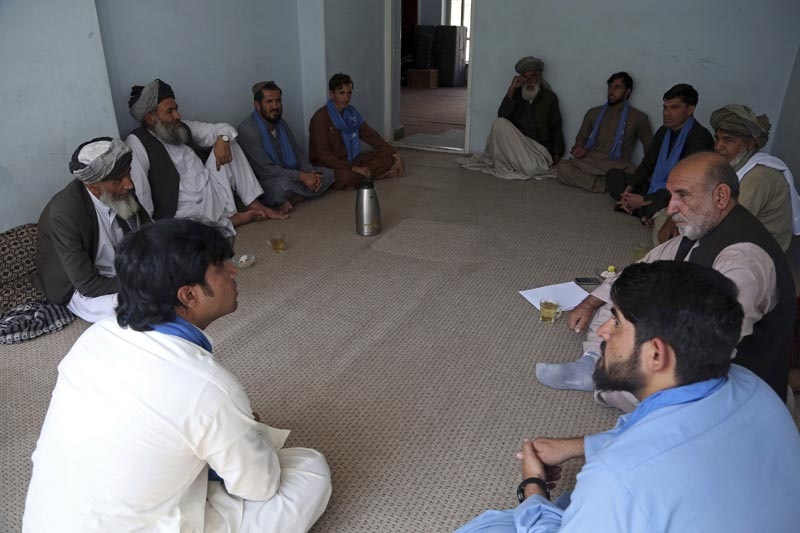 FILE - In this August 29, 2019 filephoto, members of the peace movement chat after an interview in Kabul, Afghanistan. Photo: AP