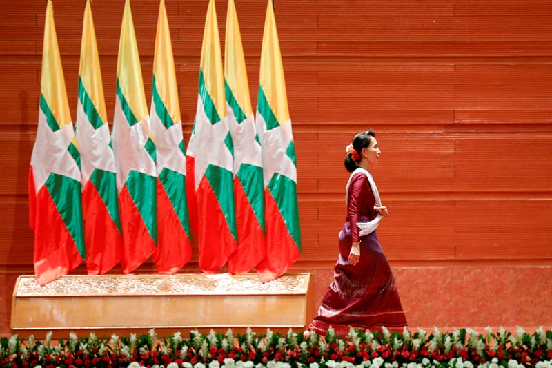FILE: Myanmar State Counselor Aung San Suu Kyi walks off the stage after delivering a speech to the nation on the Rakhine and Rohingya situation, in Naypyitaw, Myanmar September 19, 2017. Photo: Reuters