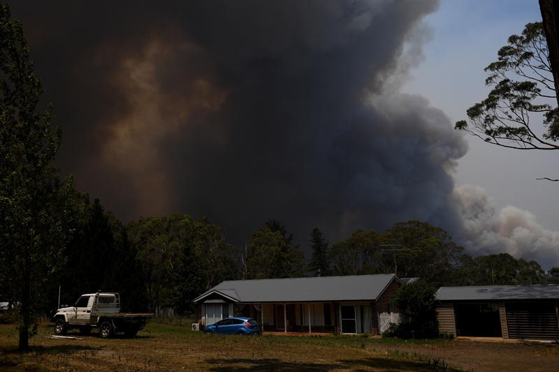 A home is seen as smoke from the Grose Valley Fire rises in the distance, at Bilpin, New South Wales, Australia, December 21, 2019. Photo: Reuters