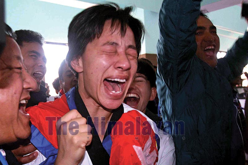 Ayasha Shakya reacts after winning gold medal in Pumsae of Taekwondo during the 13th South Asian Games at Satdobato in Lalitpur on Monday. Photo: Udipt Singh Chhetry/ THT