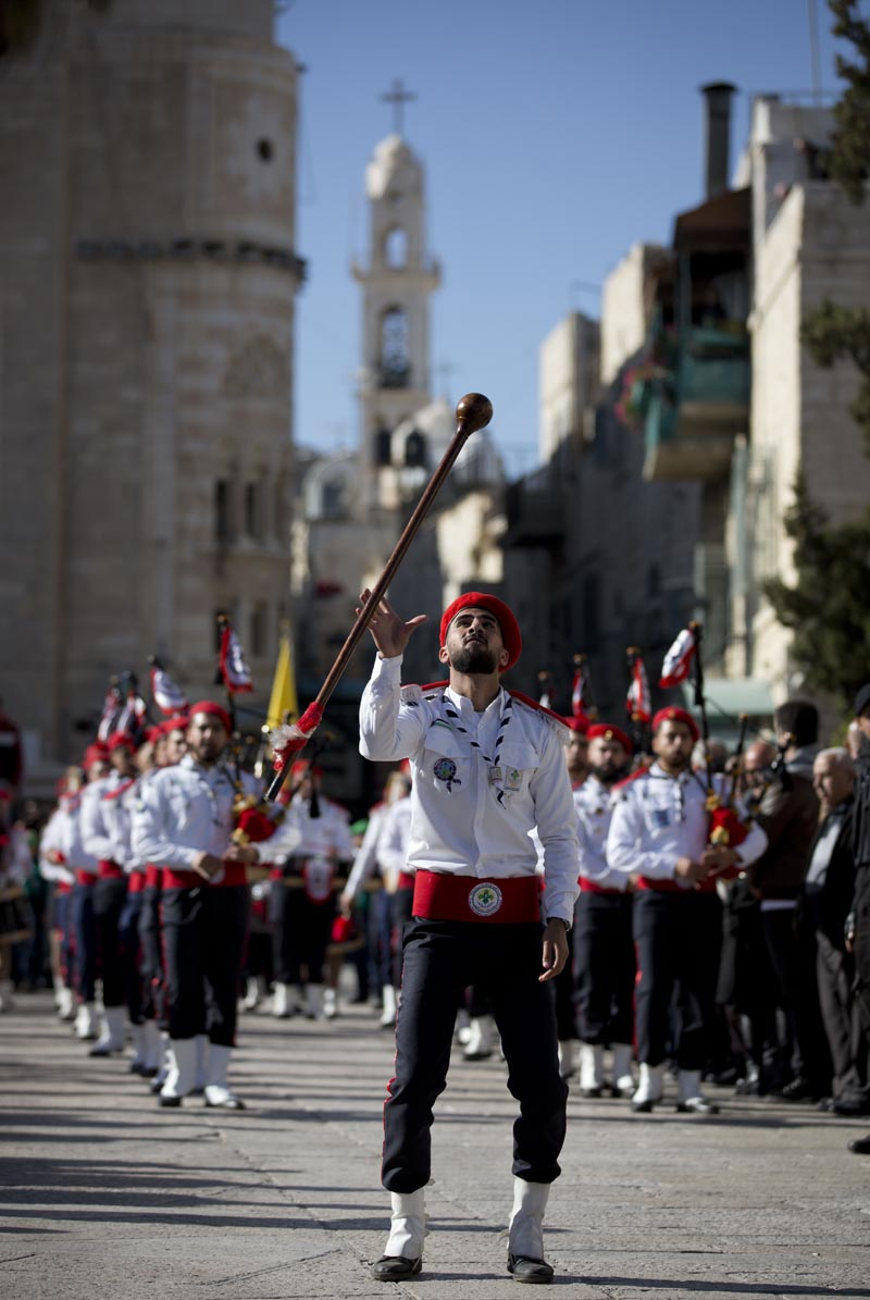 A Palestinian Scout marching band parade during Christmas celebrations outside the Church of the Nativity, built atop the site where Christians believe Jesus Christ was born, on Christmas Eve, in the West Bank City of Bethlehem, Tuesday, Dec. 24, 2019. Photo: AP