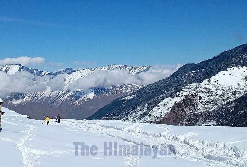People walking through the Martadi-Kolti road stretch after continuous snowfall disrupted vehicular movement, in Bajura, on Sunday, December 15, 219. Photo: THT