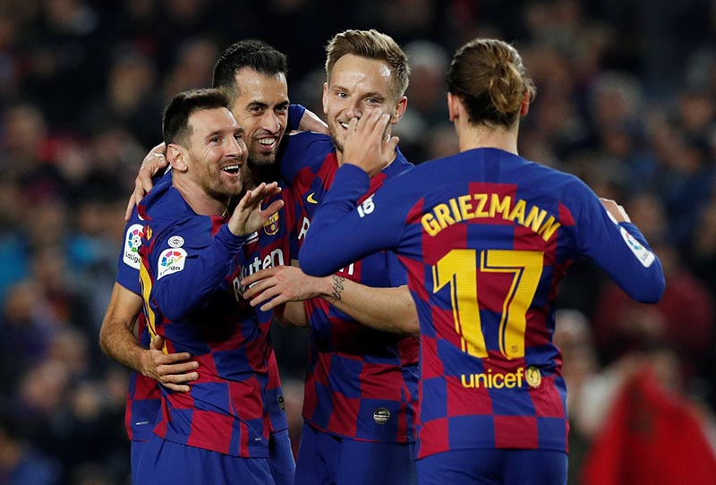 Barcelona's Lionel Messi celebrates scoring their second goal with teammates during the La Liga Santander between FC Barcelona and RCD Mallorca, at Camp Nou, in Barcelona, Spain, on December 7, 2019. Photo: Reuters
