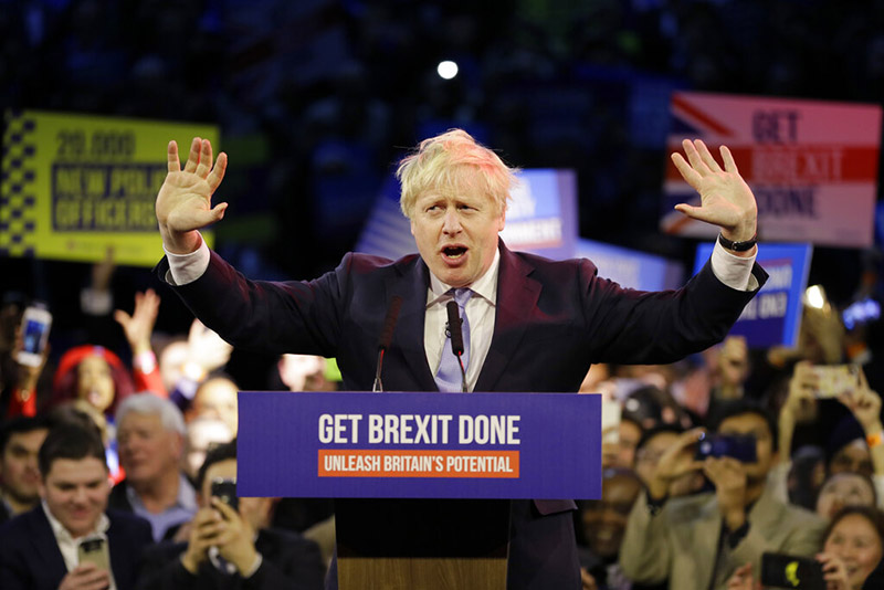 Britain's Prime Minister Boris Johnson speaks during his ruling Conservative Party's final election campaign rally at the Copper Box Arena, in London, Wednesday, December 11, 2019. Britain goes to the polls on December 12. Photo: AP