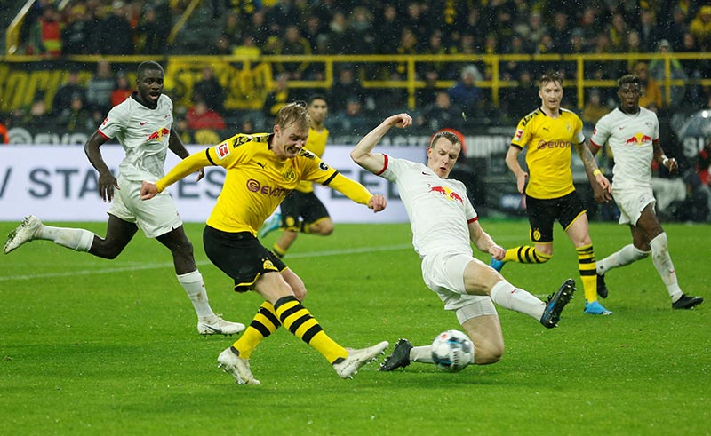Borussia Dortmund's Julian Brandt in action with RB Leipzig's Lukas Klostermann during the Bundesliga match between Borussia Dortmund and RB Leipzig, at Signal Iduna Park, in Dortmund, Germany, at December 17, 2019. Photo: Reuters