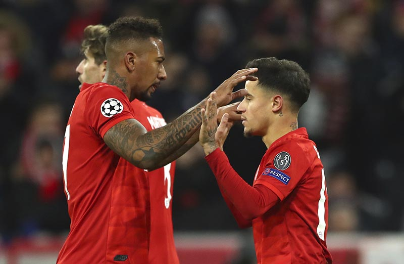 Bayern's Philippe Coutinho (right) celebrates with Bayern's Jerome Boateng after scoring his sides third goal during the Champions League group B soccer match between Bayern Munich and Tottenham Hotspur at the Allianz Arena stadium, in Munich, on Wednesday, December 11, 2019. Photo: AP