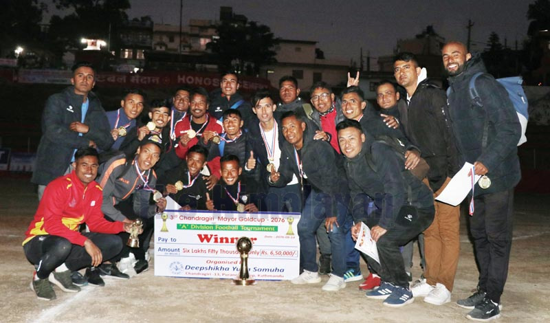 Players and officials of Nepal APF Club celebrate after winning the third Chandragiri Mayor Gold Cup at the Naikap grounds in Kathmandu on Saturday, November 30, 2019. Photo: THT
