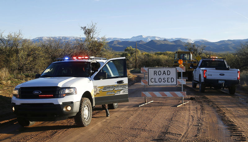 The photo shows the road closed near Bar X road and Tonto Creek after a vehicle was washed by flood waters in Tonto Basin, Arizona, Saturday, Nov 30, 2019. Photo: Patrick Breen/The Arizona Republic via AP