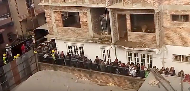 A number of Chinese nationals being arrested from a residence in Manamaiju, Kathmandu, on Monday, December 22, 2019. Photo courtesy: Kiran Giri/YouTube