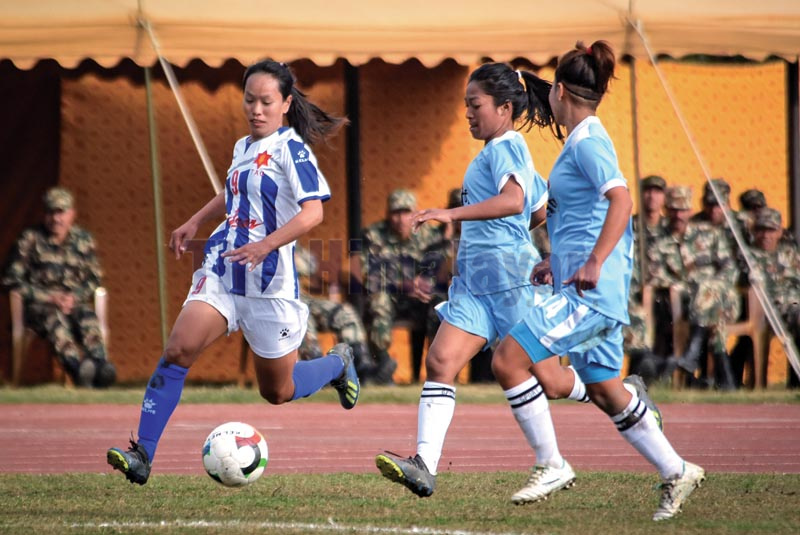 TAC's Sharmila Thapa Magar (left) vies for the ball with Province-1 players during the opening match of the seventh CoAS International Women's Football Tournament in Kathmandu on Sunday, December 15, 2019. Photo: Naresh Shrestha / THT