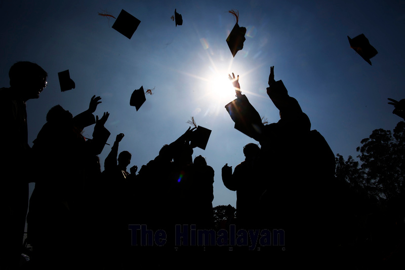 Graduate students toss their hats in the air during the 45th Convocation Day of Tribhuvan University (TU), the oldest university in Nepal, at Pulchowk Engineering College in Lalitpur, on Thursday, December 19, 2019. More than 10,000 students participated in the convocation ceremony. Photo: Skanda Gautam/THT