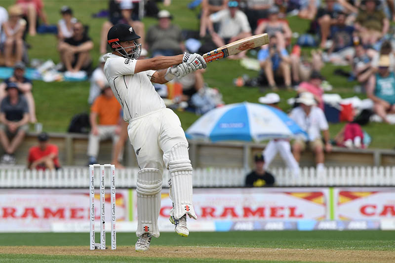 New Zealand's Daryl Mitchell hits a boundary. Photo: Reuters