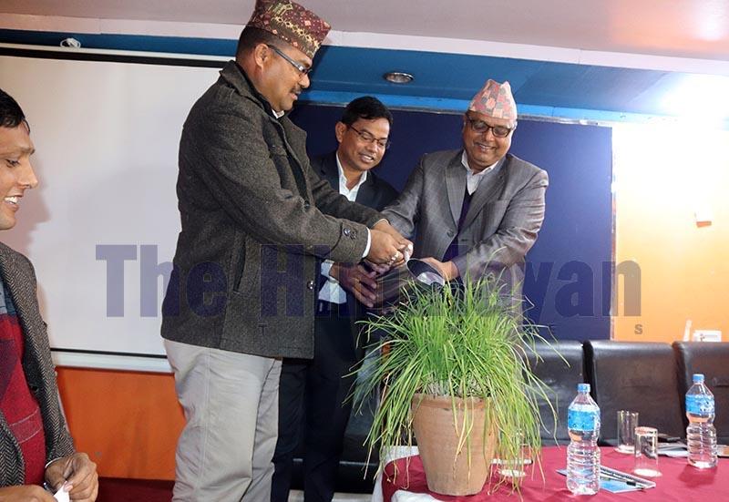 Dhangadhi sub-metropolis Mayor Nripa Bahadur Odd (left) watering a plant to inaugurate an interaction on nenvironment, in Dhangadi, on Sunday, December 8, 2019. Photo: THT