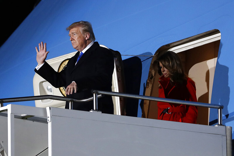 US President Donald Trump waves as he and US first lady Melania Trump arrive at Stansted Airport in England, on Monday, December 2, 2019. US President Donald Trump will join other NATO heads of state at Buckingham Palace in London on Tuesday to mark the NATO Alliance's 70th birthday. Photo: AP Photo
